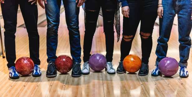 five man standing bowling balls